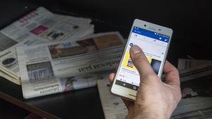 Sosiaalisen median kanava ja printtilehtiä.