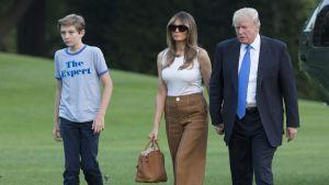 Barron, Melania ja Donald Trump palaamassa Valkoiseen taloon 11. kesäkuuta.