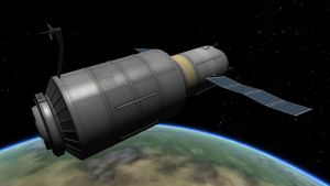 Sylinterin muotoinen avaruuasema, sivuilla pitkät aurinkopaneelisiivet. Alla kaartuu osa maapallosta.
