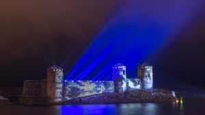 15th century three-tower castle of Olavinlinna illuminated in honour of Finland's 100th year of independence, in Savonlinna, Finland.