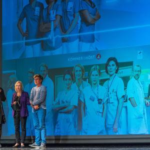 "Finnish writer Petja Peltomaa, moderator Liselott Forsman and CEO/producer Jan Blomgren discussing ""Nurses"" remake."