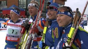 Sami Jauhojärvi, Ville Nousiainen, Virpi Kuitunen ja Aino-Kaisa Saarinen parisprinttien jälkeen vuonna 2009.