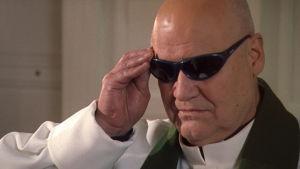 Oiva Lohtander pappina elokuvassa Nyrölä 3.