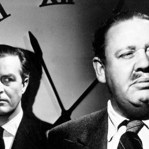 Ray Milland ja Charles Laughton elokuvassa Kohtalon kello