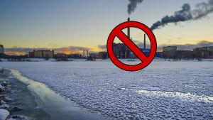 hiilivoimala talvisessa maisemassa ja sen päällä kieltomerkki