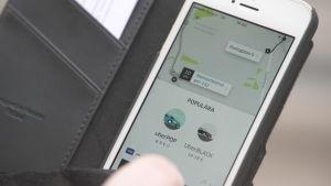 Ubers applikation i en smarttelefon