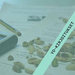 Kuvassa laskin, yo-koe ja eväinä olleita pähkinöitä.