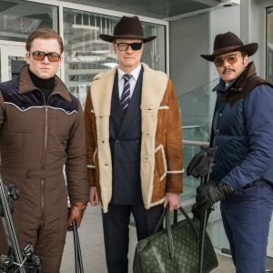 Trion Eggsy, Harry och Whiskey poserar.