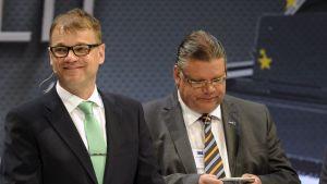 Partiledarna Jyrki Katainen (Saml), Juha Sipilä (Centern), Timo Soini (Sannf) och Antti Rinne (SDP) i Musikhuset.