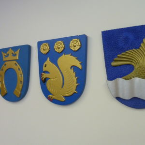 Kommunvapen för Helsingfors, Esbo, Vanda och Grankulla.