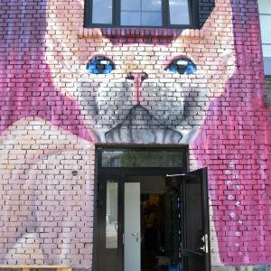 Väggmålning föreställande siameskatt.