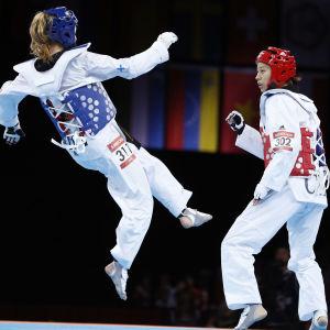 Suvi Mikkonen i kvartsfinalmatchen mot Kinas Hou Yuzhuo i London-OS 2012.