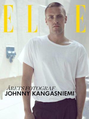 Johnny Kangasniemi. Det står Elle i bakgrunden (bild som visades när han vann priset för Årets fotograf.