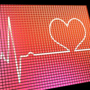 Monitor med symbol för puls och hjärta.