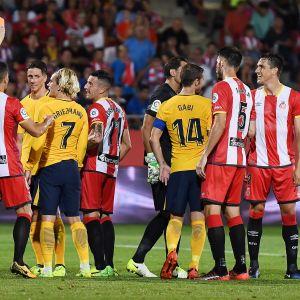 Antoine Griezmann blev utvisad då Atletico Madrid spelade 2-2 mot Girona.