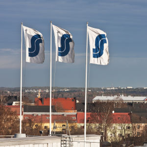 Flags with Finnish S-group logos.