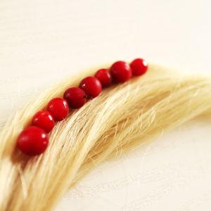 Använd lingon för att färga håret ljusrött.