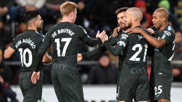 Manchester City-spelare firar lagets första mål.