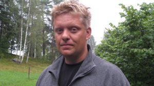 Arkeolog Henrik Jansson.