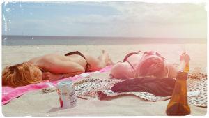 Kuvituskuva: auringonottajia rannalla.