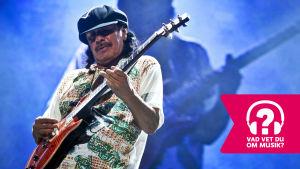 Santana spelar elgitarr.