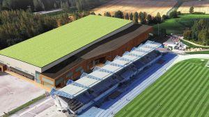 Arkitektbild över ny idrottshall i Alberga, här ser man hur hallen ligger precis intill stadions läktare