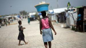 Kvinna i flyktingläger i Port Port-au-Prince i juli 2010