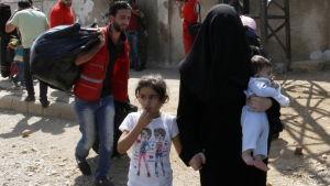 Evakuering av kvinnor och barn i Homs 22.9.2016.