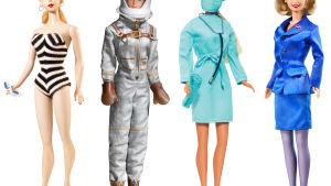 neljä barbie nukkea