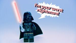 """Darth Vader som legofigur står med ett lasersvärd i handen och säger """"I'm your worst nightmare""""."""