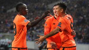 Sadio Mané, Jordan Henderson och Roberto Firmino firar Liverpools 4–0-mål.