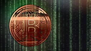 Ett bitcoin mynt med kod i bakgrunden.