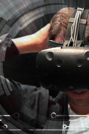 Graafisesti käsitelty kuva, jossa miehellä VR-lasit päässä