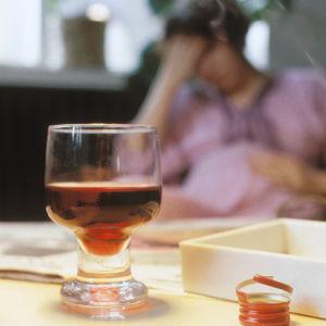 Kvinna med alkohol
