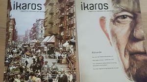två tidskrifter där det står Ikaros på ligger på ett ljust golv.
