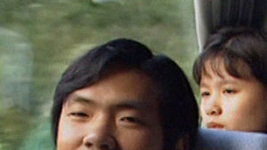 Vietnamilaisia ja suomalaisia bussissa