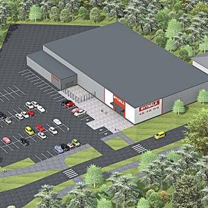 En ritning på en affärsfastighet ovanifrån. Framför byggnaden syns en parkering.