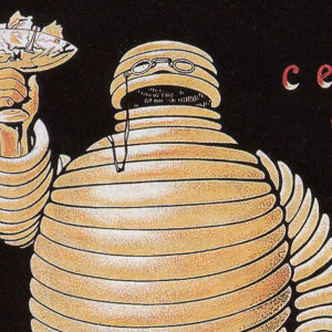 Den ursprungliga michelingubben höjer ett glas.