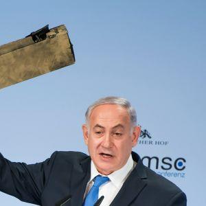 Benjamin Netanjahu oitää kädessään Iranilaisen Droonin kappaletta.