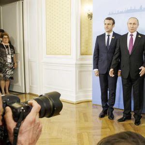 Ranskan presidentti Emmanuel Macron, Venäjän presidentti Vladimir Putin ja Saksan liittokansleri Angela Merkel tapasivat G20-kokouksessa
