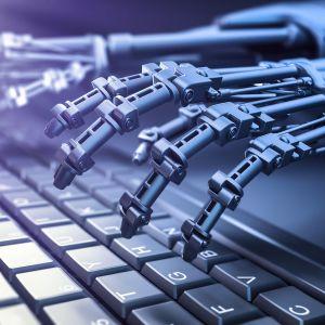 Robotti käyttää tietokoneen näppäimistöä.