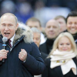 Presidentti Vladimir Putin on kampanjoinut vain harvakseltaan ennen vaaleja.