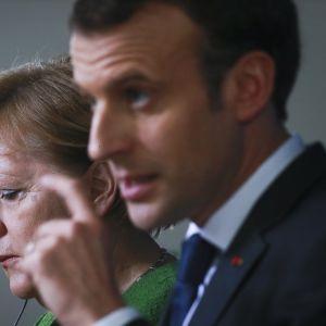Lähikuvassa miehen ja naisen kasvot.