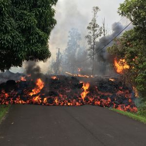 A handout photo made available by the United States Geological Survey (USGS) shows lava flow moving on Makamae Street in Leilani Estates, near Pahoa, Hawaii, USA, 06 May 2018 (issued 07 May 2018).