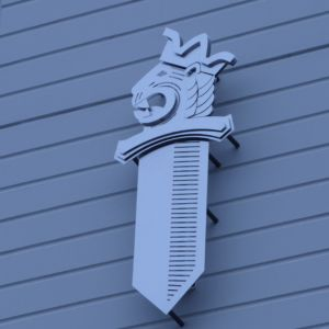 Poliisin vaakuna poliisilaitoksen seinällä.