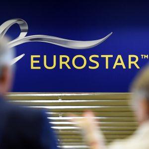 Eurostarin logo, edustalla kaksi ihmistä.