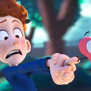 Nuori poika ampuu sormenpäästään sydämen.