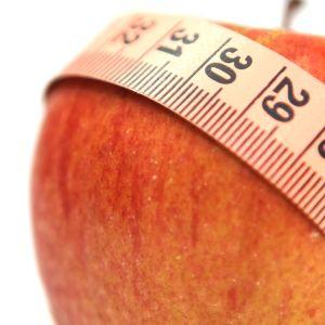 Bild på äpple och måttband