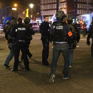 Polisen har spärrat av brottsplatsen och skärpts säkerheten ytterligare på tåg och vid järnvägsstationer efter en serie våldsdåd