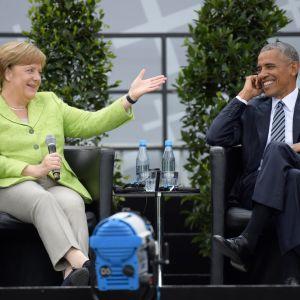 Förbundskansler Angela Merkel och USA:s förre president Barack Obama diskuterar demokrati vid Brandenburger Tor. 25.5.2017